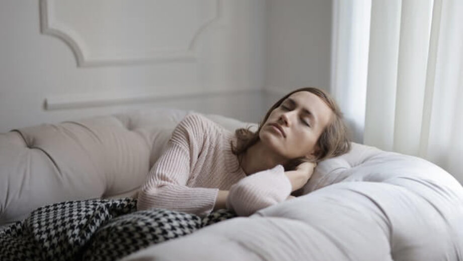 girl-in-white-sweater-lying-on-couch-3786636 (1)