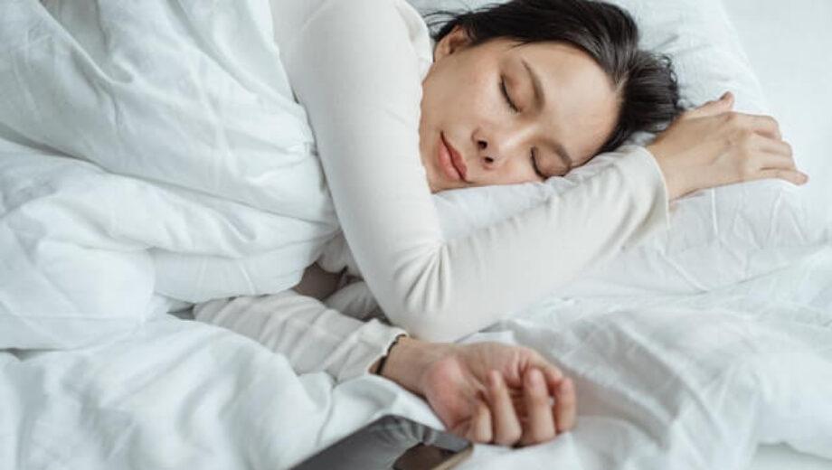 woman-sleeping-in-bed-near-smartphone-4473864-1