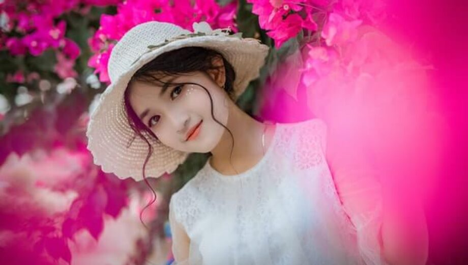 woman-surrounded-by-pink-bougainvillea-flowers-1382728 (1)