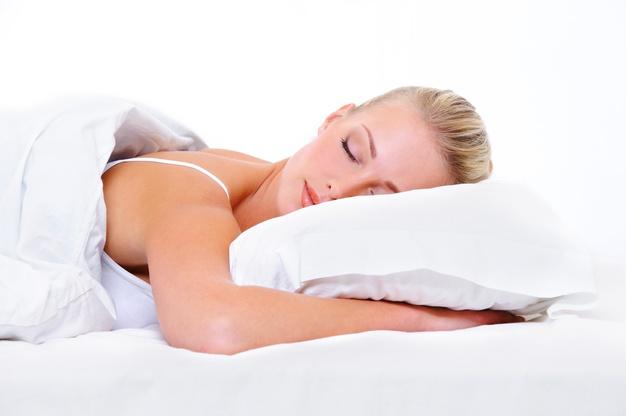 women sleeping on clean pillow case