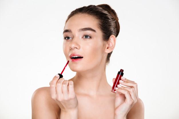 Applying a lipstick