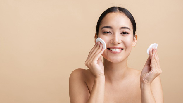 use cotton pads to pop a pimple